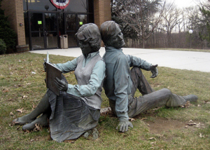 sculpture front of the library