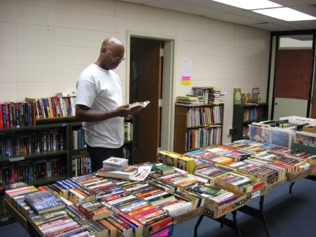 Man browsing daily book sale.